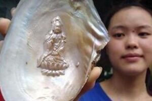 仙女湖蚌内观音菩萨像之谜,河蚌内长出超逼真观音菩萨像